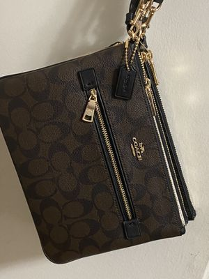 Brand New Authentic Coach big wristlet with tags, box , bag for Sale in Rockville, MD