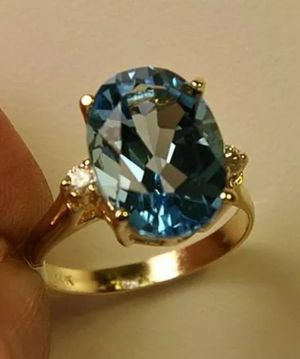 A beautifull 14k solid fine gold 7.25 ct Blue Topaz and diamond lady's ring for Sale in Ontario, CA