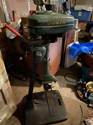Elgin outboard motor 1940s, Boat stand cast iron it's a mercury keikhaefer for Sale in Sugar Creek, MO