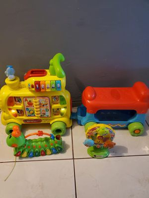 VTECH TRAIN, A CATERPILLAR TOY AND A WHEEL OF FORTUNE TOYS for Sale in Miami, FL