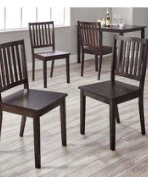 2 dark brown dining chairs still in box. (2 ) chairs