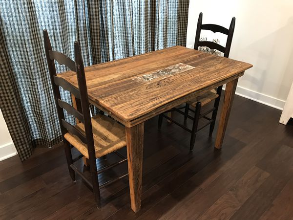 Vintage Farmhouse kitchen table and two ladder back chairs.
