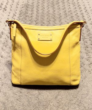 Kate Spade pebble leather shoulder bag paid $285 Color Yellow. Measurements approx 11in L, 2in W, 10.5 H. Has a blemish on back of bag & minor pen ma for Sale in Washington, DC