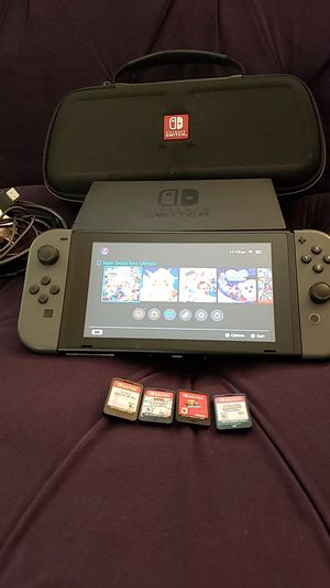 Nintendo Switch with 4 games and dock for Sale in Las Vegas, NV