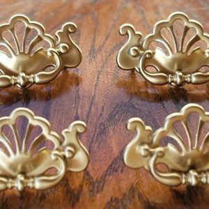 4 OLD VINTAGE ANTIQUE DRAWER PULLS for Sale in Modesto, CA