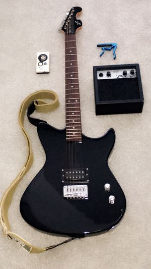 Entire guitar set (Includes: Electric guitar with strap, AMP, auto tuner, and capo) for Sale in Flower Mound, TX