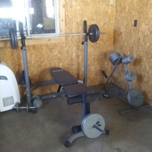 Exercise Equipment Steel And Cast iron Weights Bench And Bars (Everything Sold Together) for Sale in San Antonio, TX