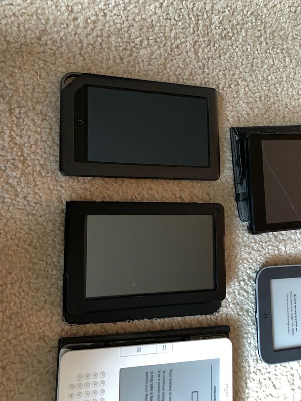 Mixed lot of kindles and nook (FOR PARTS)