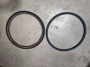 2 tires - 27x1.25 & 26x2.125 for Sale in Lombard, IL