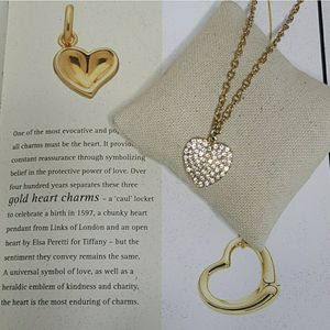 Guess pave heart pendant necklace gold for Sale in Las Vegas, NV