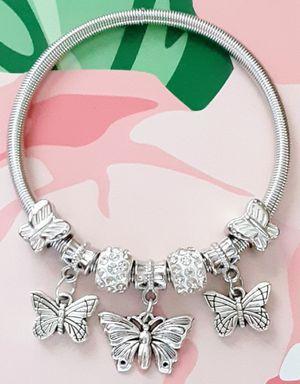 New silvertone flexible coil butterfly charm bracelet for Sale in Fullerton, CA