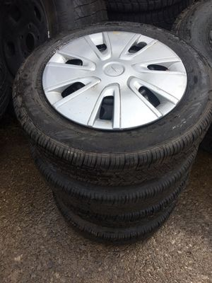 4 Mitsubishi Mirage steel rims/hub caps and tires for Sale in Cleveland, OH