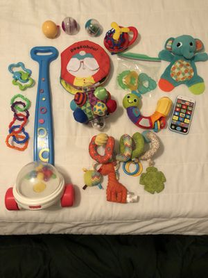 Assortment of baby toys, book, car seat toy and teethers for Sale in Kathleen, GA