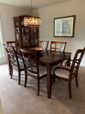 Dining Table. Walnut color. Solid. 6 chairs and expanding leaf included. for Sale in Covington, WA