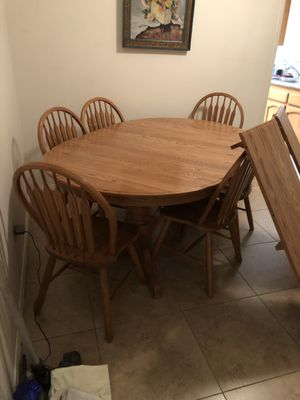 Solid Oak table with 6 chairs and 2 center leafs for Sale in Highland, CA