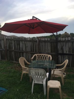 Chairs table and hang over Umbrella for Sale in Bellview, FL