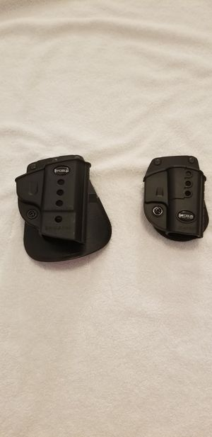 Smith and wesson holsters 9mm/40 cal big one and small one is Glock 42 for Sale in Webb City, MO