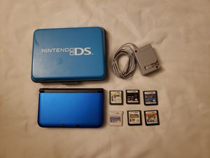 Nintendo 3ds XL with 6 games and hard shell carrying case for Sale in Las Vegas, NV