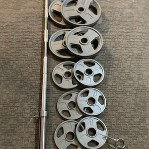 *New In box 300lb Olympic Weight Set With 7' 45lb Olympic Bar** for Sale in Seattle, WA