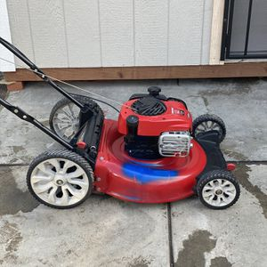 Troy-Bilt 21 in. 160 cc Honda Gas Walk Behind Push Mower with High Rear Wheels and 3-in-1 Cutting TriAction Cutting System for Sale in Arvin, CA