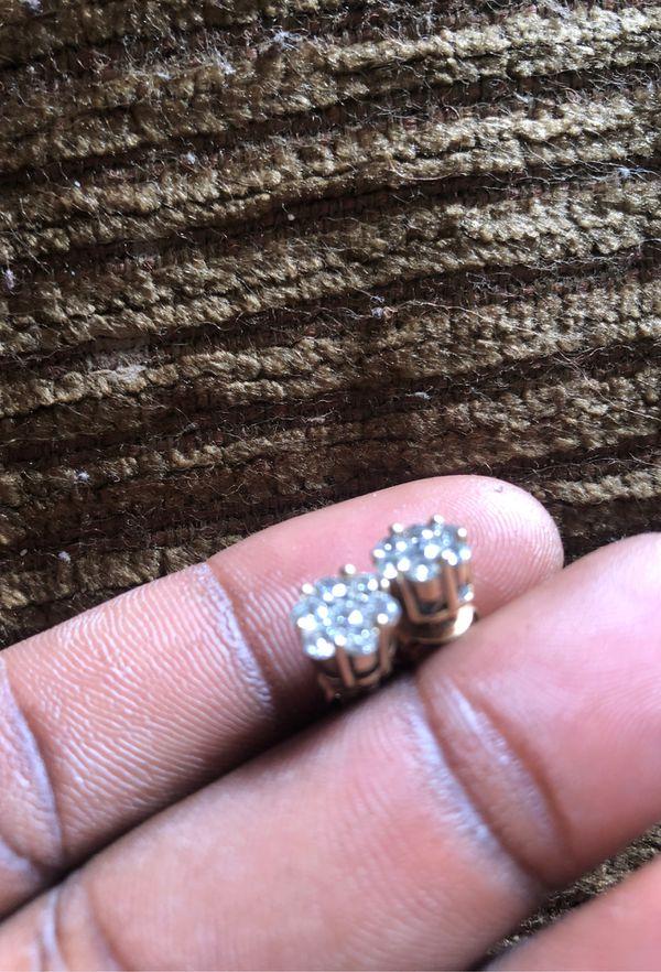 Real 1/2 kt diamond earrings.