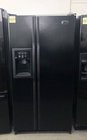 """Comes with free 6 Months Warranty-like new 33 1/2"""" inches wide black side by side refrigerator Ge for Sale in Detroit, MI"""