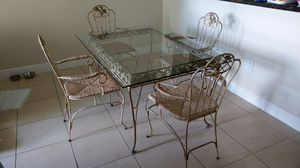 Whimsical glass dining table with four chairs for Sale in West Palm Beach, FL