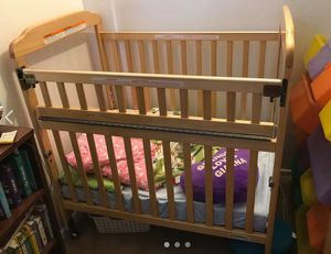 Beautiful mini crib Foundations Serenity on wheels. Neutral color for both genders. Excellent condition!!!! for Sale in Costa Mesa, CA