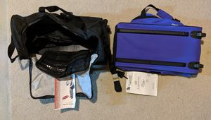 Set of brand new rolling Carry-on duffle bag tote with wheels for Sale in Grand Blanc, MI