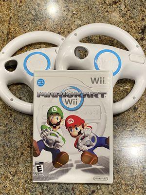 Wii MarioKart with 2 Wii Wheels for Sale in Goodyear, AZ