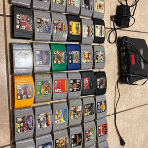 Nintendo 64 With2 Controls And A lot Of Game Rumble Pak And Memory Pak for Sale in Miami, FL