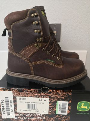 Brand new jonh deere steel toe work boots for Sale in Riverside, CA
