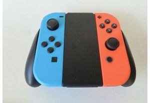 Nintendo Switch Gray 32GB Console with Neon Red and Neon Blue Joy-Con + 2 Games for Sale in Irving, TX