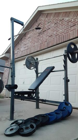 Bench press rubber coated weights and bar for Sale in Saginaw, TX
