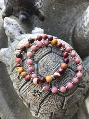 Jasper and rhodochrosite stretch bracelets with flowe charms. Size 7 inches for Sale in Stockton, CA
