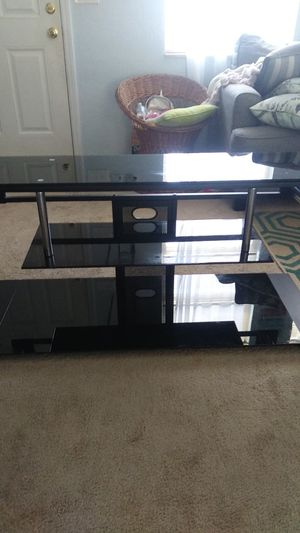 Glass entertainment center in perfect condition for Sale in Port Charlotte, FL