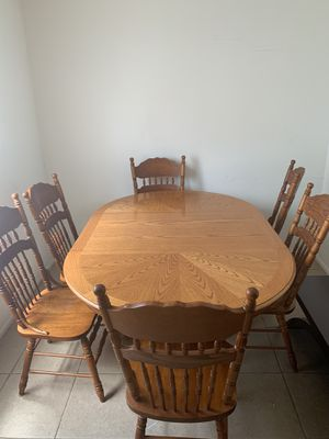 Wooden dining table for Sale in Melbourne, FL