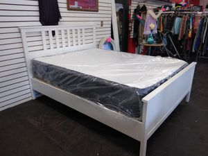 Queen-size brand new Casper still in plastic never been used on a white bed frame for Sale in Tampa, FL