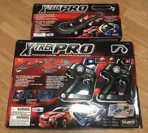 X-Trek Pro Rc tracks and cars - working for Sale in Indianapolis, IN