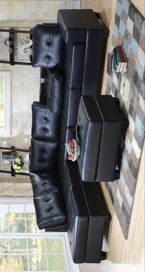 Heights black faux leather reversible sectional with storage ottoman for Sale in Houston, TX