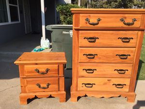 Tall dresser with five drawers and one night stand in good condition all drawers open fine. for Sale in Fresno, CA