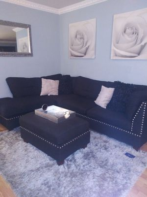Black sectional with ottoman and two end tables for Sale in Woodbridge, VA