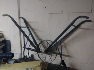 2 cVintage high wheel plows for Sale in Montgomery, AL