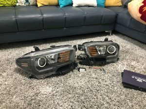 Tacoma retrofit headlights blacked out. Halo drl and side marker switchback for Sale in Salt Lake City, UT