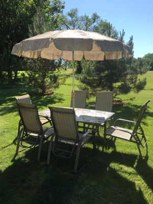 Patio set nine pieces, six reclining chairs, rectangle table, base stand, Umbrella, very very nice and comfortable $475 for Sale in Varna, IL