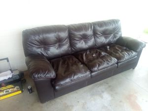 Very nice vinyl leather couch with no scratches and it has not had any animals on it no cats no dogs in great shape for Sale in Phoenix, AZ