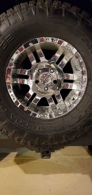 5 Metal moto 17x9 wheels with 4 bridge stone dueler a/t 315/70/17 for Sale in Fort Worth, TX