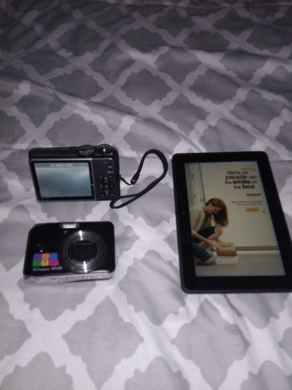 2 digital cameras and Kindle