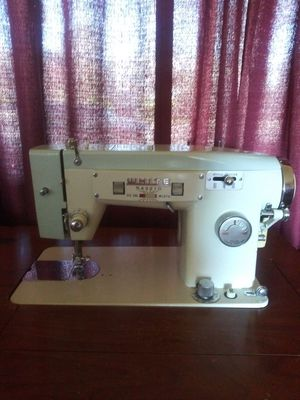 White brand sewing machine in cabinet for Sale in Oroville, CA