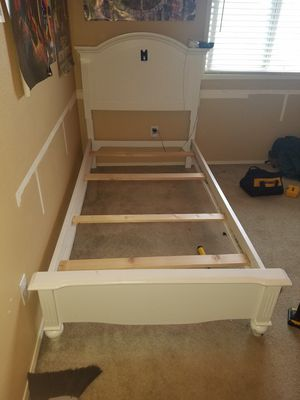 We have 2 Twin size bed frames. 1 brown 1 white. for Sale in Pasco, WA